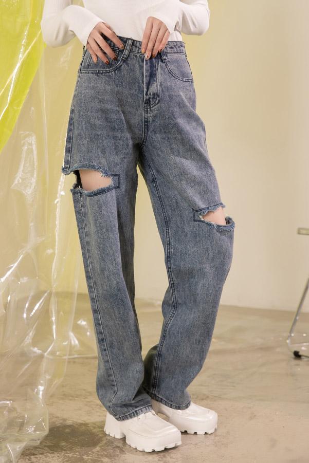 嬉皮風不對稱大破洞寬鬆老爹牛仔褲